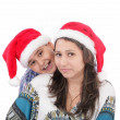 Cheerful boy and woman in Santa Claus hat. Isolated on white bac — Stock Photo #13438951