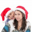 Cheerful boy and woman in Santa Claus hat. Isolated on white bac — Stock Photo