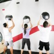 Stock Photo: Man and Woman Doing Crossfit on gym. Crossfit Series