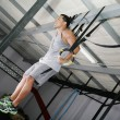 Young gymnast training on rings — Stock Photo