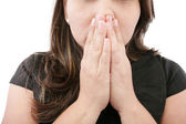 A young woman praying with her hands together on white backgroun — Stock Photo