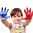 Beautiful little girl with her hands in the paint — Stock Photo