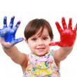 Beautiful little girl with her hands in the paint — Stock Photo #13917491