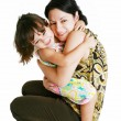 Closeup portrait of mother and daughter in white studio — Stock Photo