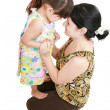 Beautiful latin mother and daughter smiling with love at each ot — Stock Photo