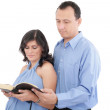 Attractive couple reading the Bible — Stock Photo