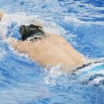 Man swims in swimming pool — Stock Photo #14500645