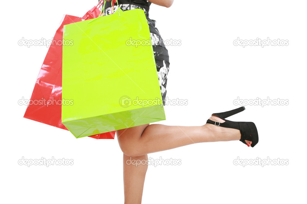 Shopping woman carrying shopping bags — Stock Photo #14830193