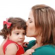 Royalty-Free Stock Photo: Happy mother kissing her daughter, isolated on white background