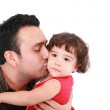 Father hugging and kissing little daughter, smiling. — Stock Photo