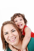 Portrait of happy daughter enjoying a piggyback ride on mothers — Stock Photo