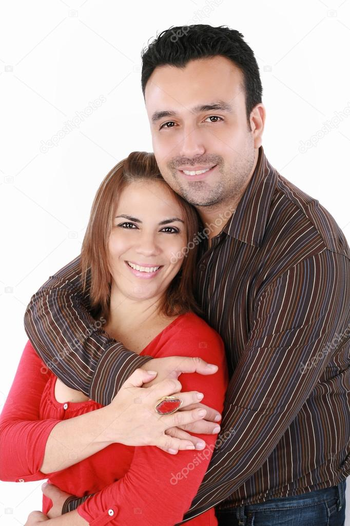 Portrait of a handsome man with his arms around his beautiful wife — Stock Photo #15639245
