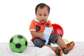 One year old baby boy enjoys playing with toys. Studio Shot. — Stock Photo