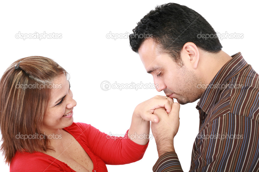 Husband kissing hand of smiling wife  Stock Photo #16040083