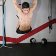 Ring dip crossfit exercise over a dark background. — Stock Photo #17423065