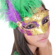Beautiful young woman in carnival mask. Isolated on white backgr — Stock Photo