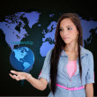 Businesswoman holding a world saying leadership — Stock Photo