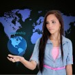 Businesswoman holding a world saying leadership — Stockfoto