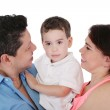 Happy Family: mother, father and son. Focus in the boy. — Stock Photo