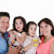 Portrait of young couple having fun with their daughter and son. — Stock Photo