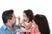 Dad, wife and daughter in the studio on a white background. Foc — Stock Photo