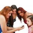 Stock Photo: A picture of a group of friends using a cellphone over white bac