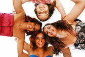 Group of happy women standing in huddle, smiling, low ange view. — Stock Photo