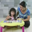 Mother teaching her little daughter to paint. — Stock Video