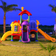 Colorful playground for childrens in the sunset. Focus on the X and 0 game. — Stock Photo #26269933