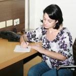 Businesswoman taking notes — Stock Photo