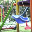 Empty single swing set. Missing of a son or daughter — Stock Video