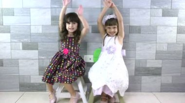 Sweet little girls inside house for playtime and hugging — Stock Video