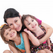 Happy mother and two daughters. Isolated on white background — Stock Photo #28697867
