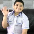 Stockvideo: Young boy waving goodbye