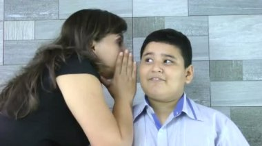 Mother whispers secret to her son — Stock Video