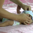 Young mother dressing her son — Stock Video
