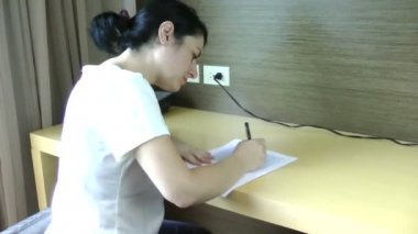 Education and school or university concept . woman studies at home. — Stockvideo
