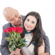 American young couple with bunch of roses — Stock Photo #39589587