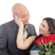 Happy woman receiving a bouquet of red roses of her lover — Stock Photo