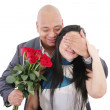 Man offering a bouquet of red roses to a woman — Stock Photo