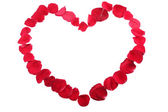 Red heart made of red rose petals — Stock Photo