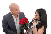 Man dating a girl giving a bouquet of flowers — Stock Photo