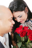 Close up of couple holding a bouquet of red roses — Stock Photo