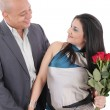 Stock Photo: Happy smiling woman with bouquet of roses holding her boyfriend