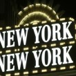 LAS VEGAS, CIRCA 2014: Neon sign welcomes visitors to the New York, New York Resort and Casino on CIRCA 2014 in Las Vegas. New York-New York uses the New York City influence of its name in many ways. — Stock Video