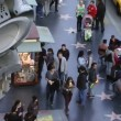 Stock Video: LOS ANGELES - CIRC2014: Tourists walking in stars on Hollywood Walk of Fame on CIRC2014 in Los Angeles, California. Hollywood Walk of Fame is main tourist attraction in Los Angeles.