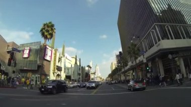 HOLLYWOOD, CA, CIRCA 2014: Driving along Hollywood Boulevard during the day circa 2014 in Hollywood. All tourist and visitors crowded on streets. — Stock Video