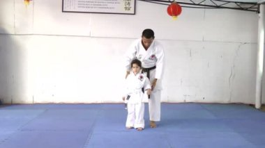 Karate master with his young student — Vídeo Stock
