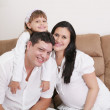 Embracing a happy family with child at home and expectant mother — Stock Photo #46632291