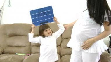 Happy girl waiting the birth of her brother. Happy family concept. — 图库视频影像